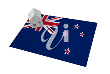 Small house on a flag - Living or migrating to New Zealand