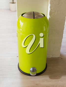 Green trash can in a dutch house