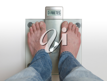 Closeup of man's feet on weight scale - Diabetes