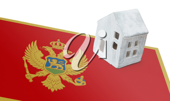 Small house on a flag - Living or migrating to Montenegro