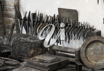Collection of vintage woodworking tools on a rough workbench - Pliers - Selective focus