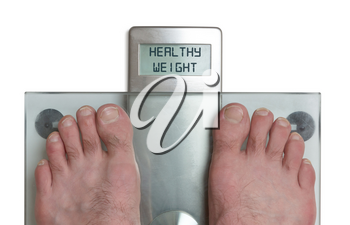 Closeup of man's feet on weight scale - Healthy weight