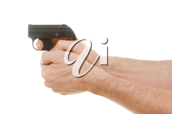 Small old alarm pistol in the hands of an adult man