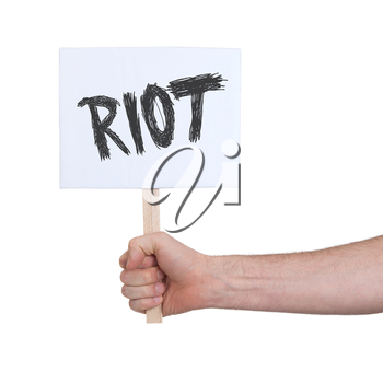 Hand holding sign, isolated on white - Riot