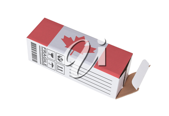 Concept of export, opened paper box - Product of Canada