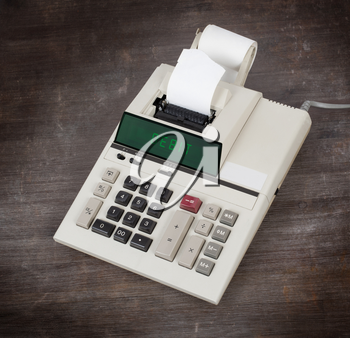 Old calculator showing a text on display - debit