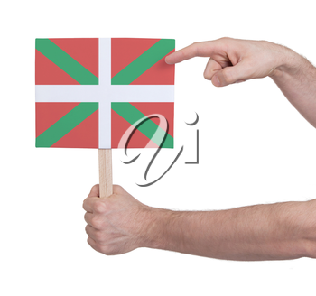 Hand holding small card, isolated on white - Flag of Basque Country