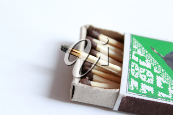 image of box full of matches and one burnt match