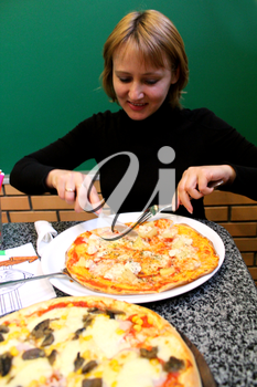 image of portrait of sympathetic young woman  in pizzeria
