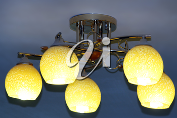 Beautiful chandelier with five bright plafonds under the ceiling