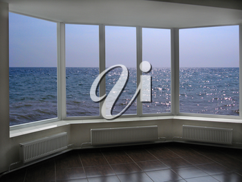 big office windows with beautiful view of marine waves