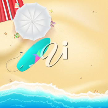 Summer travel background. Sunny sandy beach with umbrella, mat, slippers and a surfboard. Tropical seashore with a view of the surf, top view.