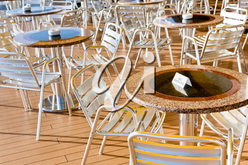 no smoking table in outdoor cafe on stern of cruise liner