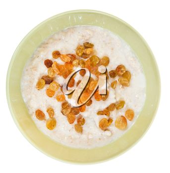 top view of traditional english oat porridge with raisins in yellow bowl isolated on white background