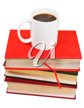 white mug of coffee on stack of books isolated on white background