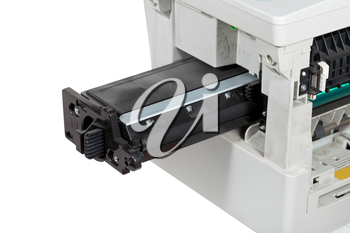 insert of toner cartridge in office multifunctional device close up