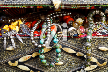 antique jewelry in ancient treasure chest close up
