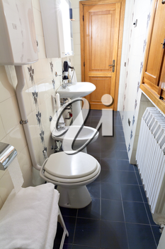 modern interior of narrow toilet room in old italian home