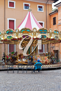 Traditional merry-go-round carousel on town square in Ravenna, Italy