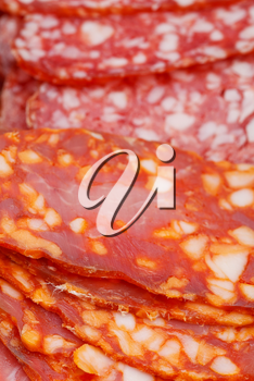 several pieces of various sliced sausages close up