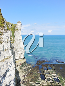 view of old oyster farm and cliff on english channel beach of Etretat cote d'albatre, France