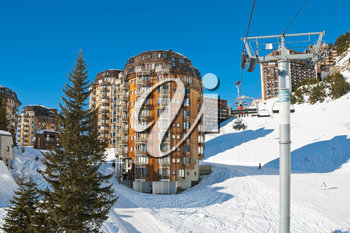 ski lift and view of Avoriaz town in Alps, Portes du Soleil region, France