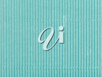 background from sheet of corrugated shiny green color paper close up