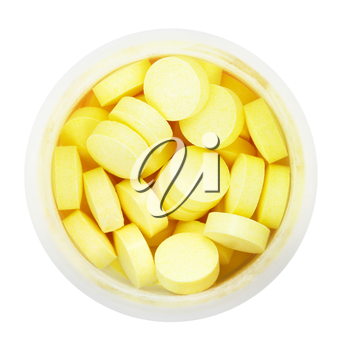 top view of yellow pills in round plastic bottle isolated on white background