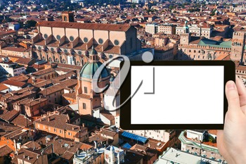 travel concept - tourist photograph above view of The Basilica of San Petronio in Bologna, Italy on tablet pc with cut out screen with blank place for advertising logo