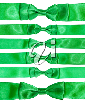 set of real bow knots on green satin ribbons isolated on white background