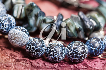 detail of gray blue necklace from natural gemstones - Dragon Veins Agate and shells beads close up