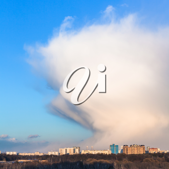 snow weather front over city in sunny spring day