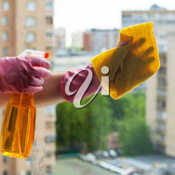 washing home window - washer cleans window glass with detergent in apartment house