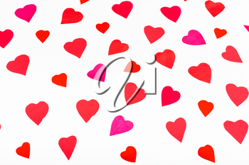 pink and red hearts cut out from paper on white background
