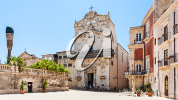 SYRACUSE, ITALY - JULY 3, 2011: visitors near Chiesa di Santa Lucia alla Badia on piazza Duomo in Syracuse in Sicily. The city is a historic town in Sicily, the capital of the province of Syracuse.
