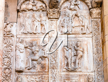 travel to Italy - medieval outdoor low relief on gate of Basilica di San Zeno ( San Zeno Maggiore, San Zenone) in Verona city