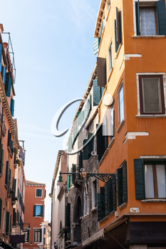 travel to Italy - residential houses on street calle del Mondo Novo in Venice city in spring
