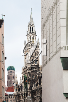 Travel to Germany - view of towers of New City Hall (Neues Rathaus) and Frauenkirche Cathedral from Old Town Hall (Alte Rathaus) on Marienplatz in Munich city
