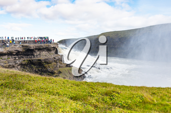 travel to Iceland - tourists on observation deck near Gullfoss waterfall in september