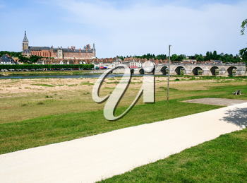 travel to France - view of Gien city from valley of Loire river in summer day
