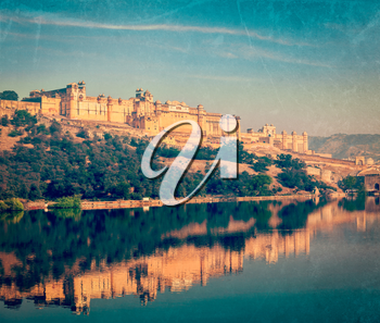Vintage retro hipster style travel image of Famous Rajasthan landmark - Amer (Amber) fort, Rajasthan, India with grunge texture overlaid