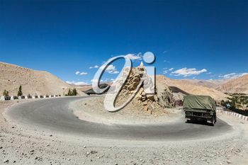 Road in Himalayas with army truck. Ladakh, India