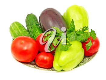 Plate with fresh vegetables isolated on white background.