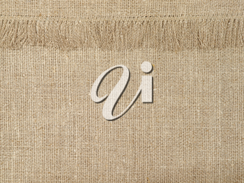 Natural linen texture pattern with fringe suitable as abstract background.
