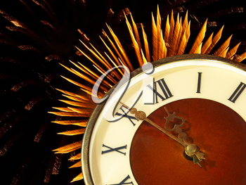 Dial of hours on a golden firework in darkness background.Eve of new year.