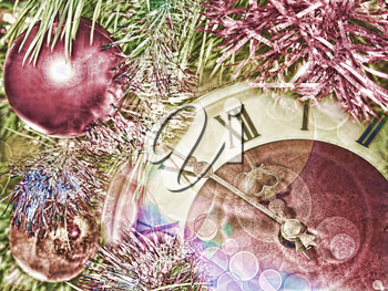 Eve of new year.Clock face and christmas balls.Toned image.