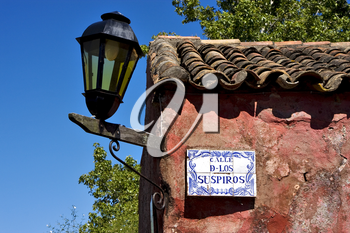 a street lamp plate plant and a wall in calle de los suspiros of house in colonia del sacramento  uruguay