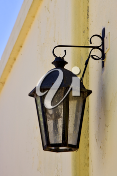 a street lamp  and a yellow wall  in calle de los suspiros in colonia del sacramento  uruguay