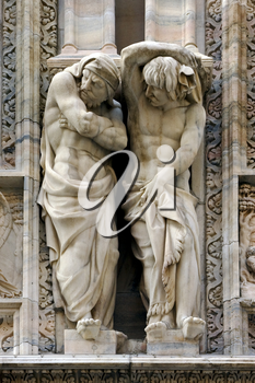 two statues in the front of the dome of milan