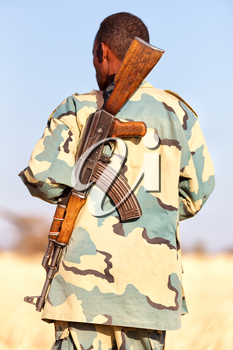 africa  in the land of ethiopia a black soldier  and his gun looking the boarder